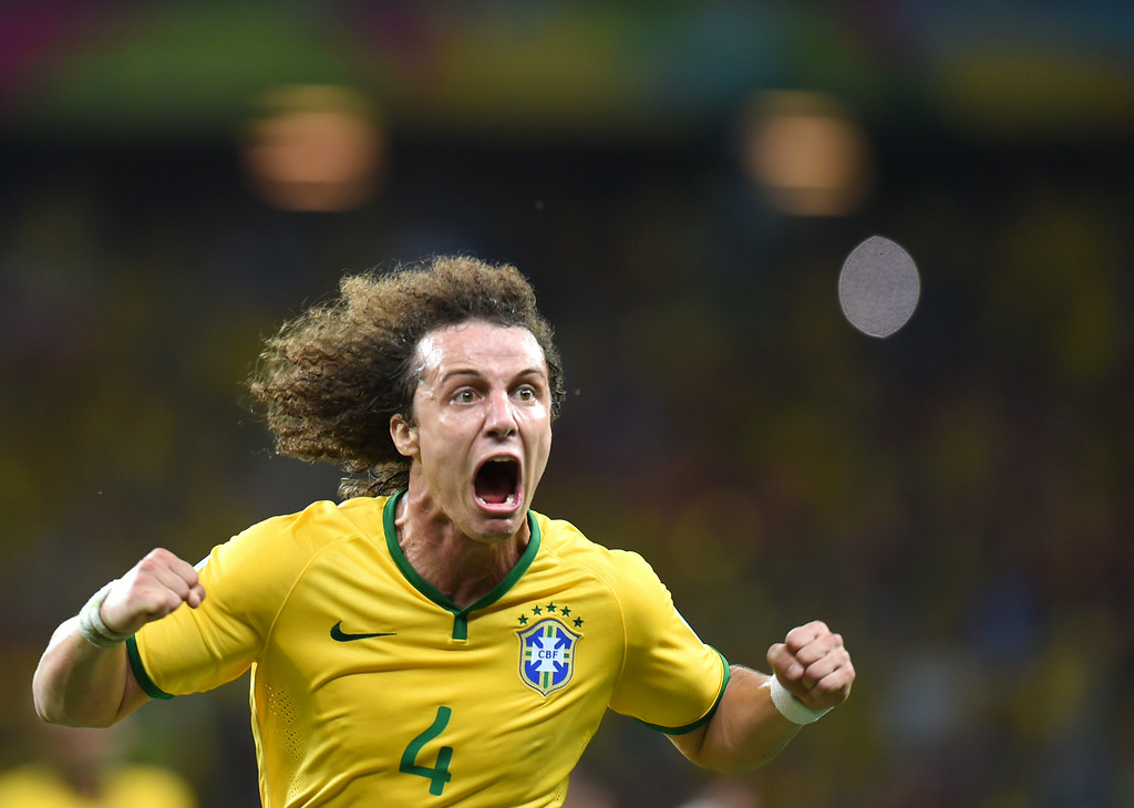 . Brazil\'s defender David Luiz celebrates scoring during the quarter-final football match between Brazil and Colombia at the Castelao Stadium in Fortaleza during the 2014 FIFA World Cup on July 4, 2014. VANDERLEI ALMEIDA/AFP/Getty Images