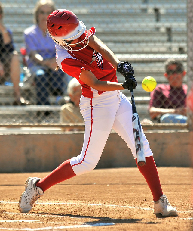 . LONG BEACH - 04/09/2013  (Photo: Scott Varley, Los Angeles Newspaper Group)  Lakewood vs Wilson girls softball at Joe Rodgers Field. Lakewood\'s Montana Dixon connects for a 3-run inside the park homer on a ball hit over the head of the Wilson right fielder.