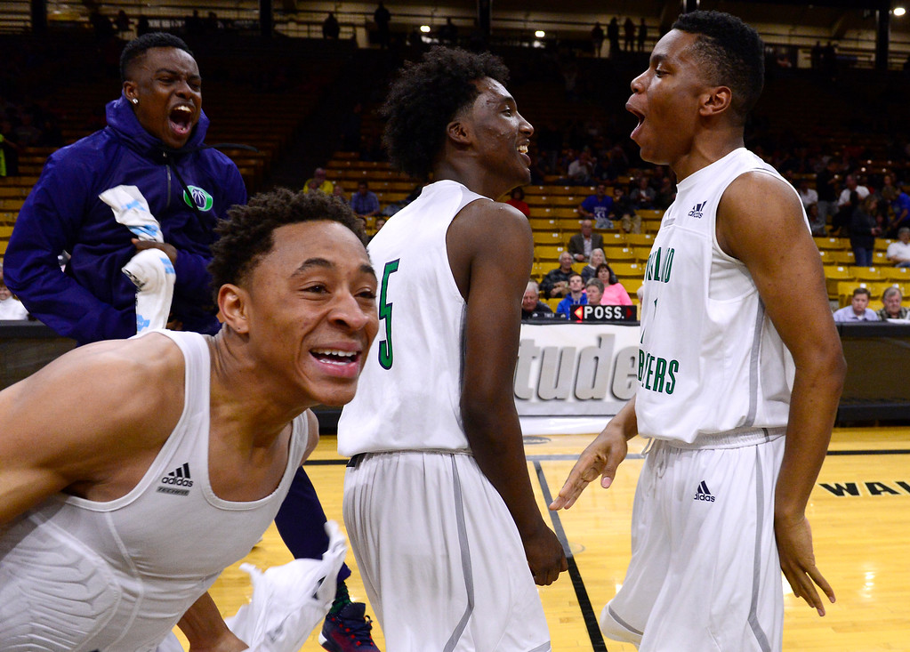 . Overland Trailblazers players run out on the court after defeating Eaglecrest Raptors at the Coors Events Center on March 12, 2016 in Boulder, Colorado. Overland Trailblazers defeated Eaglecrest Raptors 66-56 to win the Colorado State 5A Basketball Championship.  (Photo by Brent Lewis/The Denver Post)