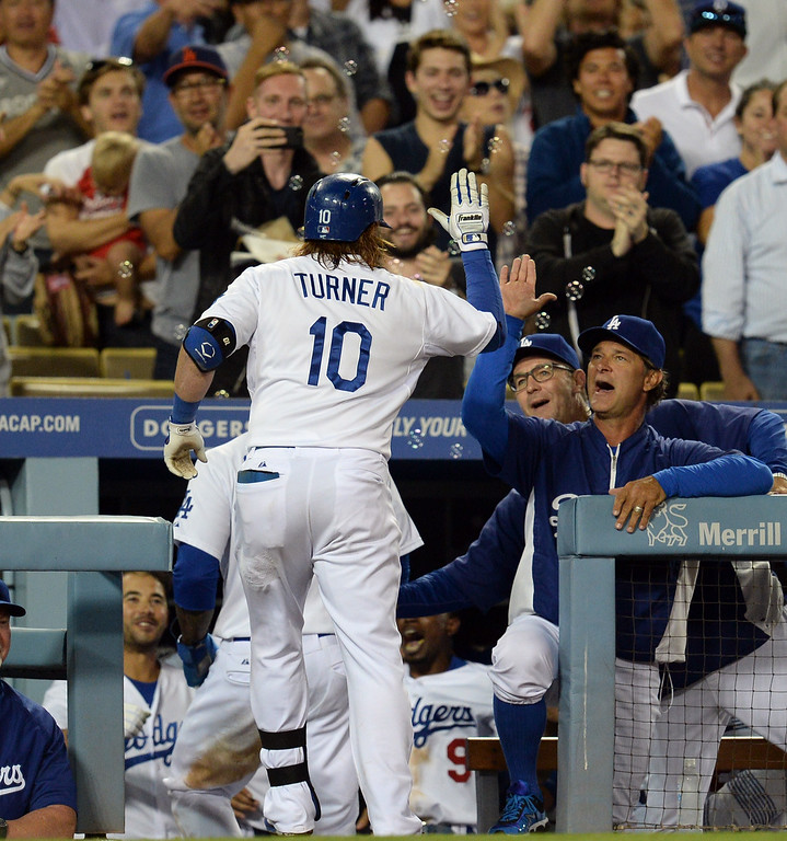 . The Dodgers� Justin Turner #10 enters the dugout after his 2-run homer in the 8th inning during their game against the Padres at Dodger Stadium Thursday, August 21, 2014. (Photo by Hans Gutknecht/Los Angeles Daily News)