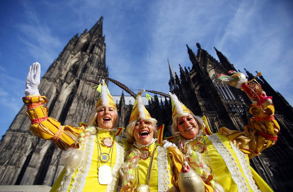 . Woman in carnival costumes pose in front of the cathedral in Cologne, Germany, 27 February 2014. The street carnival starts with the Women\'s Carnival Day in Germany\'s carnival strongholds like Mainz, Duesseldorf or Cologne, when women enter the town halls and symbolically take over power.  EPA/OLIVER BERG