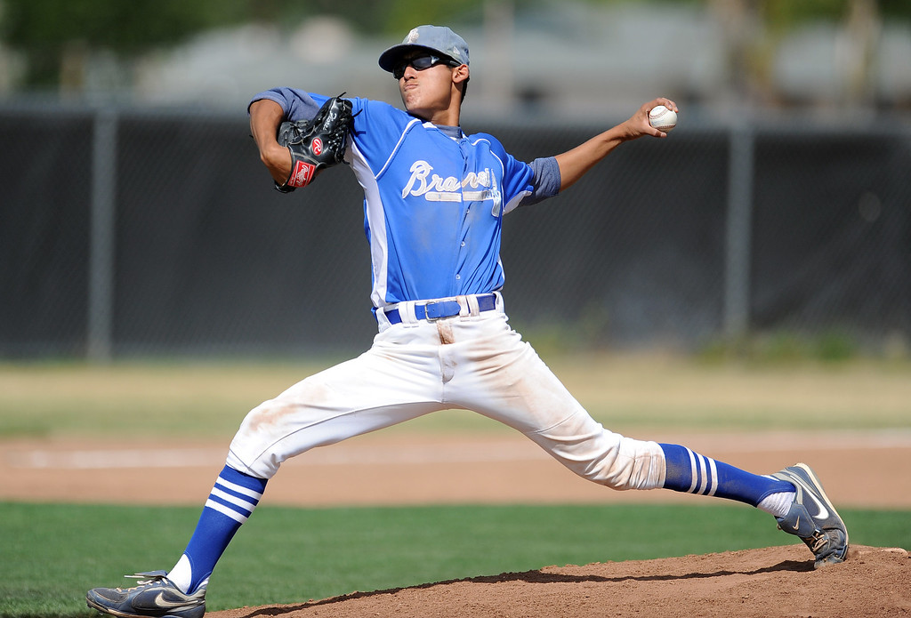 . Baldwin Park starting pitcher Bernardo Flores (C) throws to the plate in the first inning of a prep baseball game against Northview at Northview High School on Tuesday, April 23, 2012 in Covina, Calif. Northview won 8-2.    (Keith Birmingham/Pasadena Star-News)
