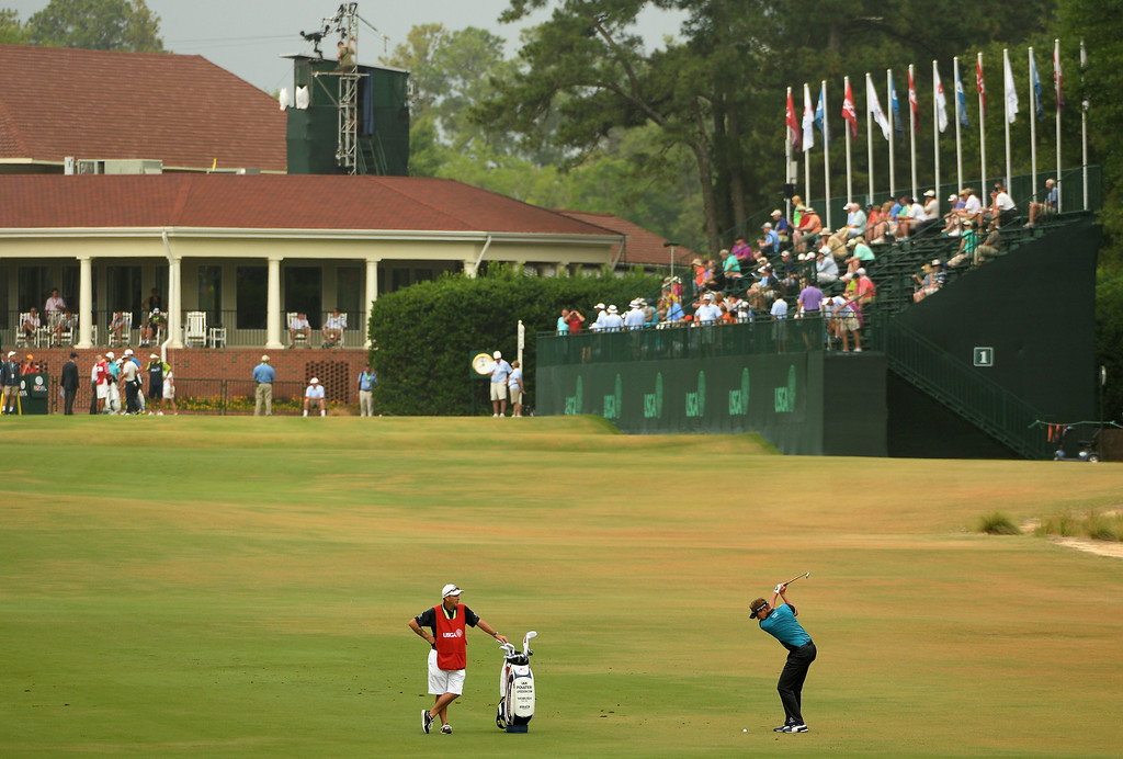 . Ian Poulter of England hits a a shot to the first green during the first round of the 114th U.S. Open at Pinehurst Resort & Country Club, Course No. 2 on June 12, 2014 in Pinehurst, North Carolina.  (Photo by Ross Kinnaird/Getty Images)