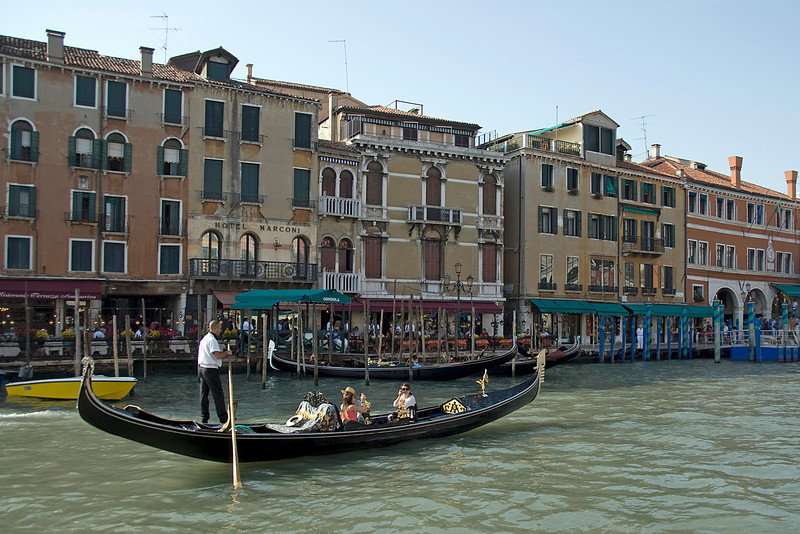 Gondola cruising over Grand Canal with a view of Venice, Italy