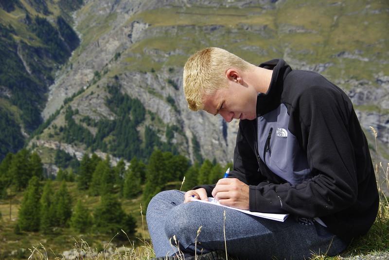 Lucas taking notes during geology lab at Sunnegga