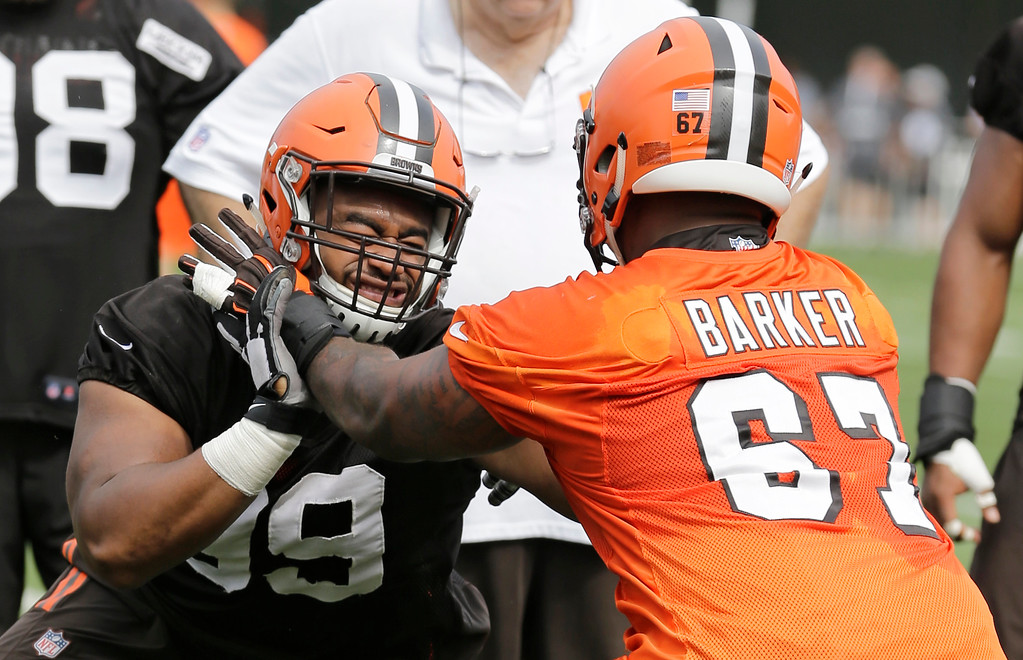. Cleveland Browns defensive tackle Caleb Brantley, left, and offensive guard Chris Barker run a drill during practice at the NFL football team\'s training camp facility, Thursday, July 27, 2017, in Berea, Ohio. (AP Photo/Tony Dejak)