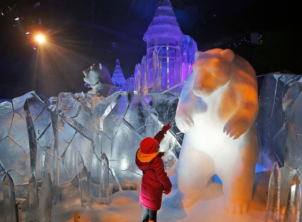 . Scarlett, 4-year-old points a look at the polar bear ice sculpture at the launch of Hyde Park Winter Wonderland\'s Magical Ice Kingdom in London, Thursday, Nov. 17, 2016. This years Winter Wonderland starts on November 18, 2016 and lasts until January 2, 2017. (AP Photo/Frank Augstein)
