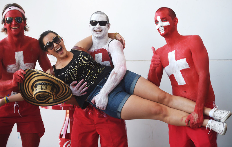 . Switzerland\'s supporters pose prior to the start of a Group E football match between Switzerland and France at the Fonte Nova Arena in Salvador during the 2014 FIFA World Cup on June 20, 2014. (DIMITAR DILKOFF/AFP/Getty Images)