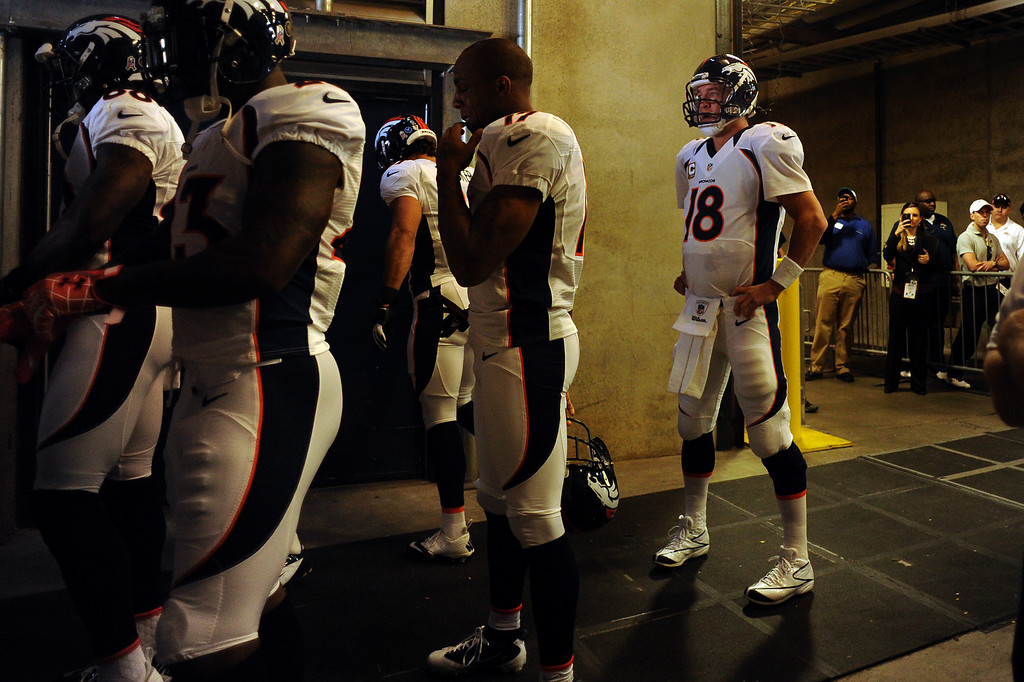 . Denver Broncos quarterback Peyton Manning #18 waiting behind his team to take the field for the second half against the Carolina Panthers at Bank of America Stadium in Charlotte, North Carolina  November 11th, 2012.      Joe Amon, The Denver Post