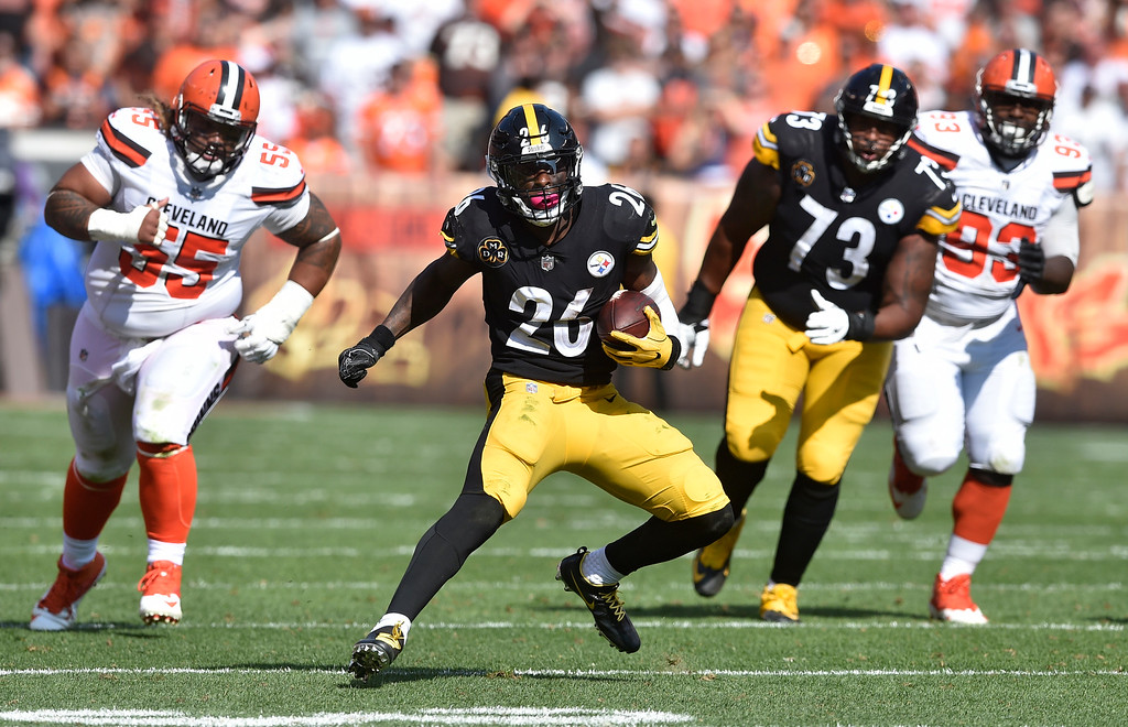 . Pittsburgh Steelers running back Le\'Veon Bell (26) runs for a first down during the second half of an NFL football game against the Cleveland Browns, Sunday, Sept. 10, 2017, in Cleveland. (AP Photo/David Richard)