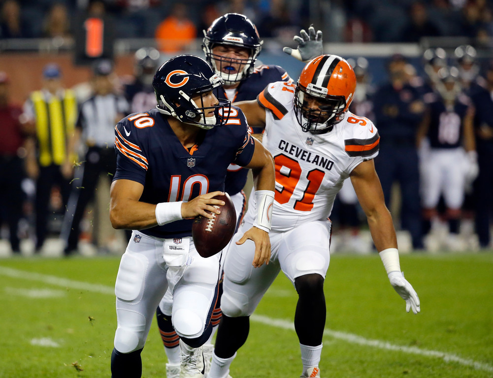 . Chicago Bears quarterback Mitchell Trubisky (10) runs against Cleveland Browns defensive end Tyrone Holmes (91) during the first half of an NFL preseason football game, Thursday, Aug. 31, 2017, in Chicago. (AP Photo/Charles Rex Arbogast)