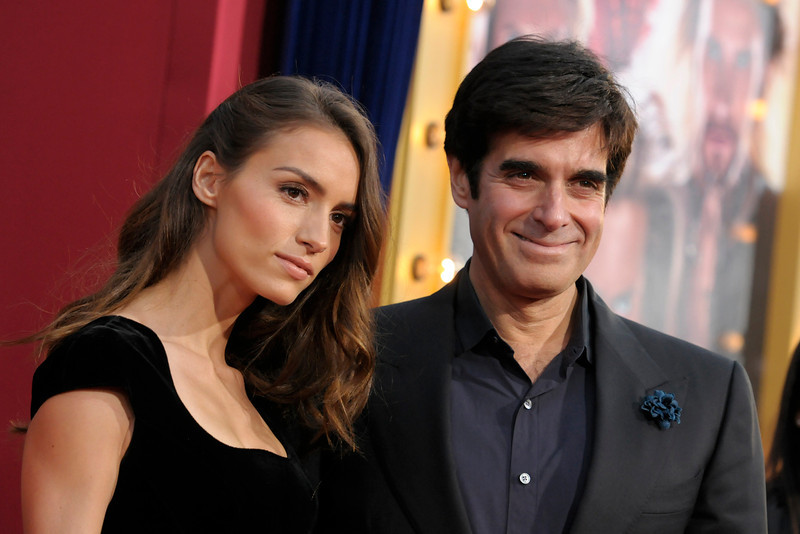 ". Illusionist David Copperfield, right, and model Chloe Gosselin arrive at the world premiere of the feature film ""The Incredible Burt Wonderstone\"" at the TCL Chinese Theatre on Monday, March 11, 2013 in Los Angeles. (Photo by Dan Steinberg/Invision/AP)"