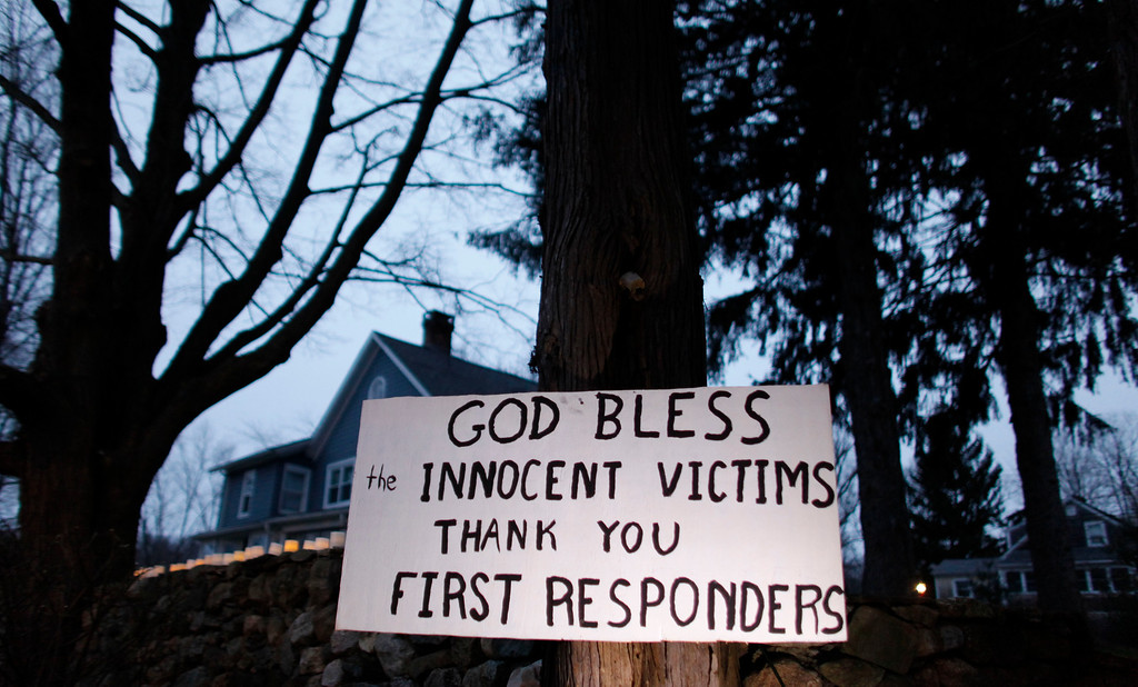 . A message of thanks and prayer is displayed outside a home in the wake of a deadly school shooting, Sunday, Dec. 16, 2012, in Newtown, Conn.  A gunman walked into Sandy Hook Elementary School in Newtown on Friday and opened fire, killing 26 people, including 20 children. (AP Photo/Jason DeCrow)