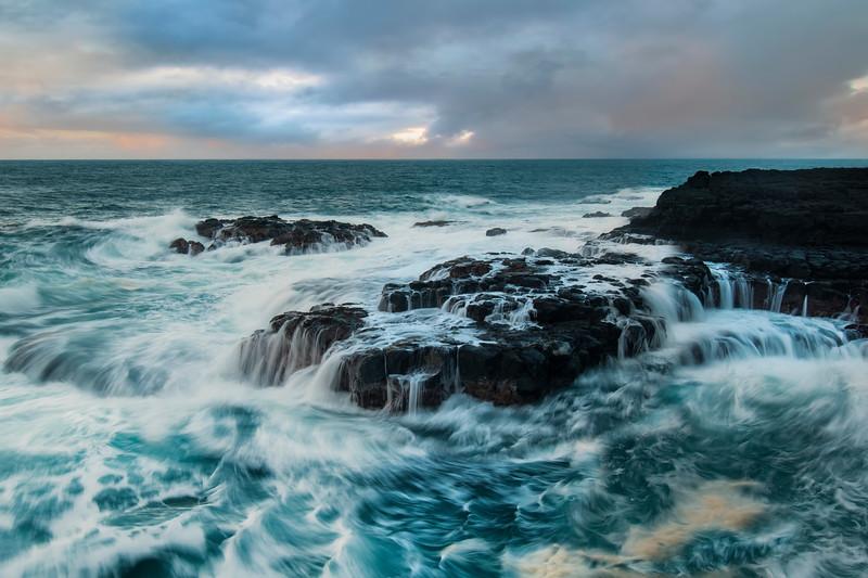 Waves running over lava rocks, Queensbath,Kauai