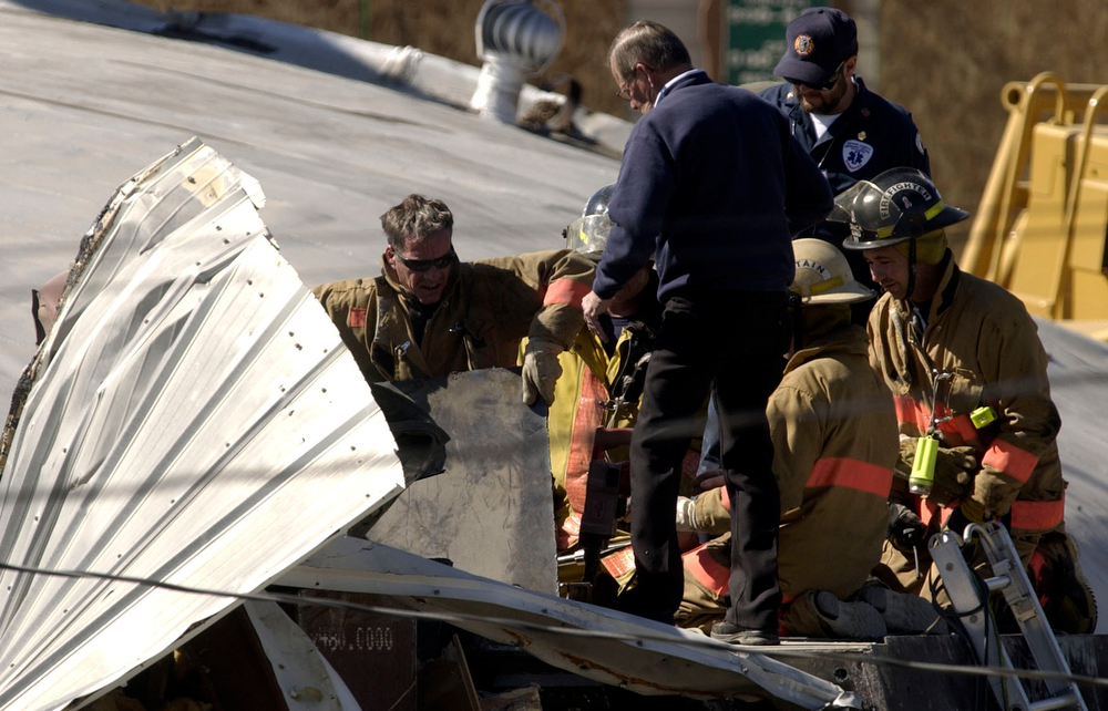 . Firefighters are making a hole on top of the Bulldozer to bring out Marvin Heemeyer\'s body at Gambles store on Saturday morning, June 5, 2004. (THE DENVER POST PHOTO BY HYOUNG CHANG)