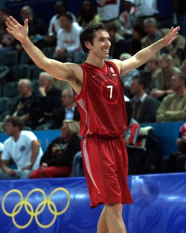 . Canada\'s Steve Nash celebrates following a 83-75 win over Yugoslavia\'s at the Dome during the 2000 Summer Olympics in Sydney, Monday, Sept. 25, 2000.  (AP Photo/Roberto Borea)