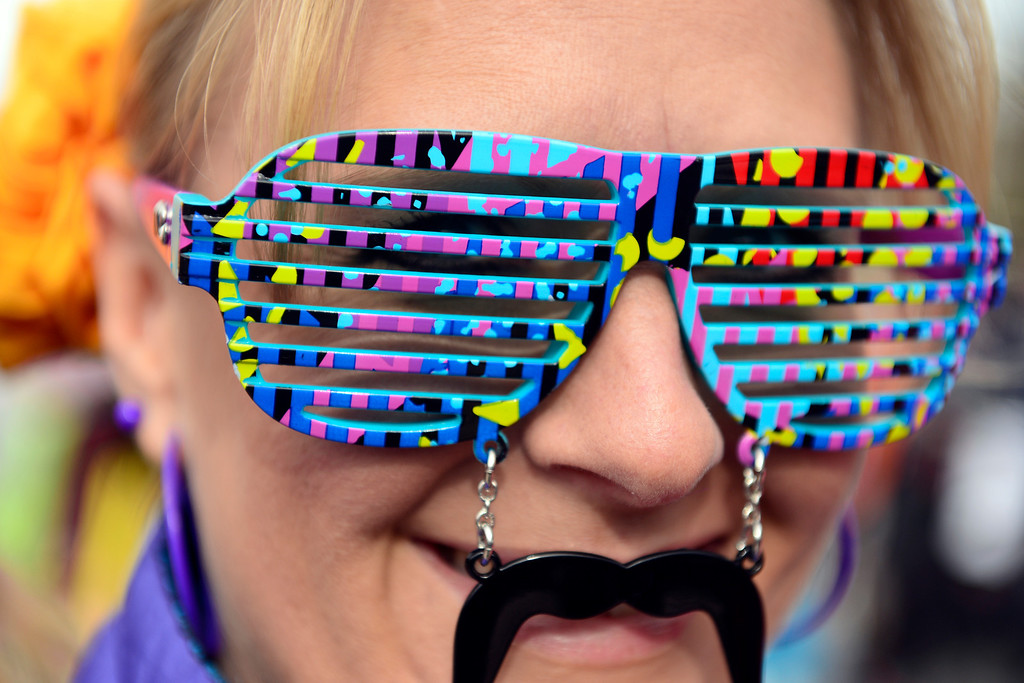 . ASPEN, CO - JANUARY 26: Nicole Lopez, of Grand Junction, rocks a mustache with novelty sunglasses during the men\'s snowboard slopestyle final. X Games Aspen Buettermilk Mountain Aspen January 26, 2013 (Photo By AAron Ontiveroz / The Denver Post)