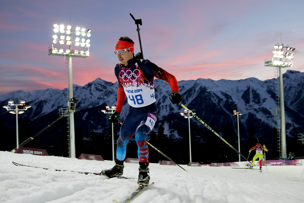 . Russia\'s Yevgeny Ustyugov competes during the men\'s biathlon 20k individual race at the 2014 Winter Olympics, Thursday, Feb. 13, 2014, in Krasnaya Polyana, Russia. (AP Photo/Jae C. Hong)