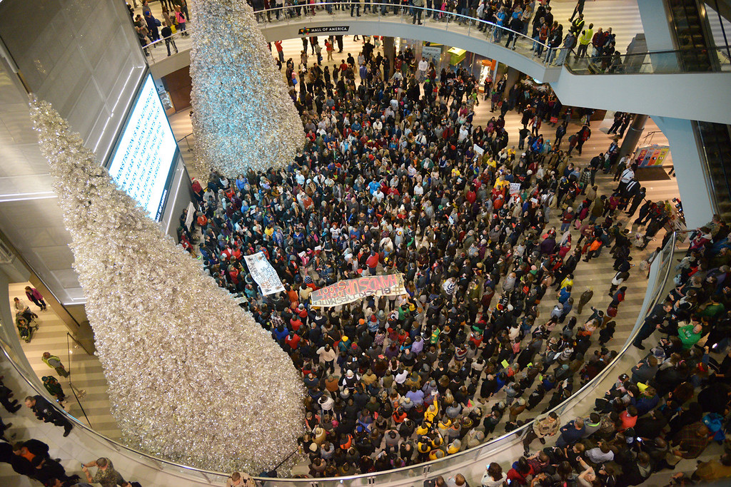 . Hundreds of demonstrators filled the rotunda while others marched around the mall. (Pioneer Press: John Autey)