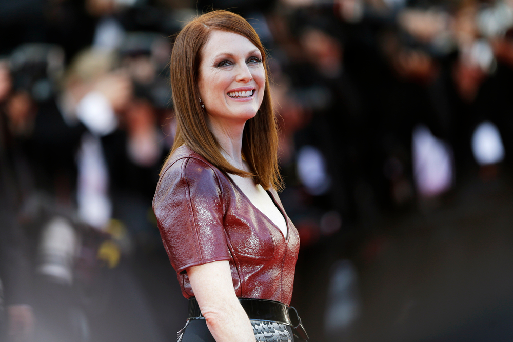 . Actress Julianne Moore poses for photographers as she arrives for the screening of Mr. Turner at the 67th international film festival, Cannes, southern France, Thursday, May 15, 2014. (AP Photo/Thibault Camus)