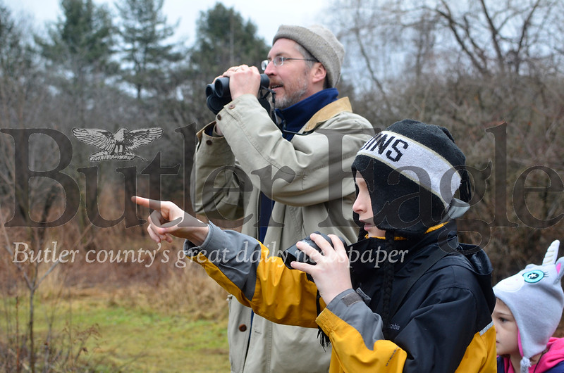 Ethan Zadnik, 12, points a bird out to his father Andy Zadnik during a bird count Saturday at Succop Nature Center. Tanner Cole/Butler Eagle