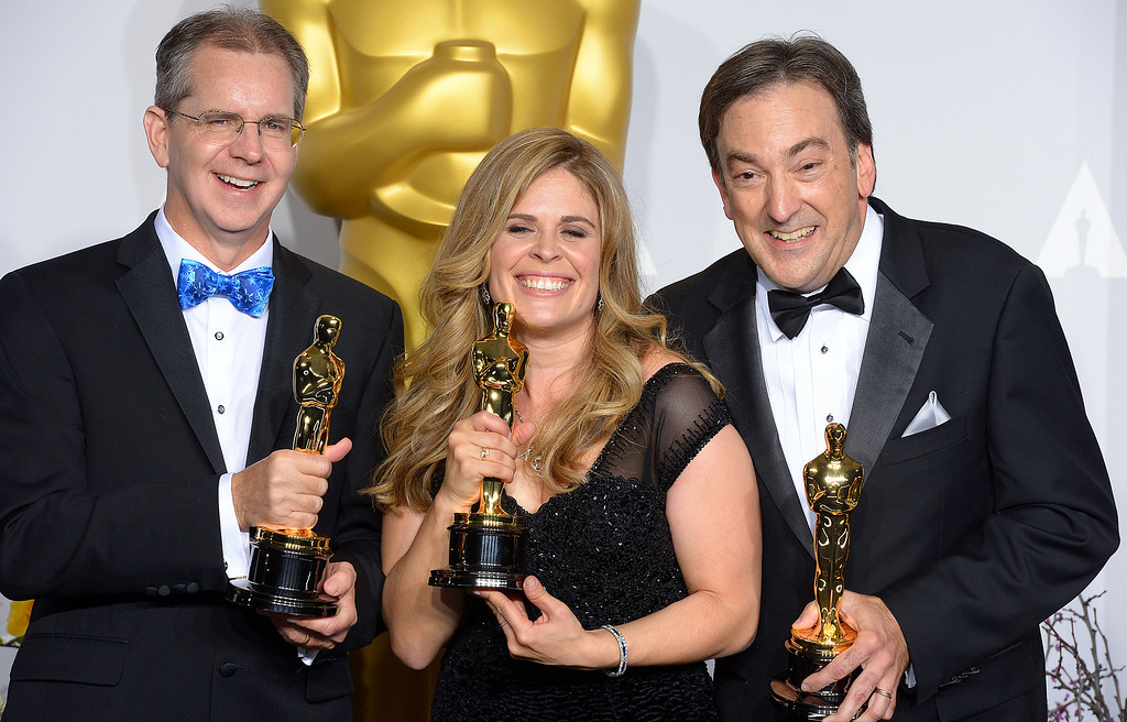 ". Directors Chris Buck, Jennifer Lee and producer Peter Del Vecho accept the Oscar for ""Best Animated Feature Film of the Year\"" for Frozen backstage at the 86th Academy Awards at the Dolby Theatre in Hollywood, California on Sunday March 2, 2014 (Photo by David Crane / Los Angeles Daily News)"