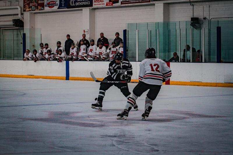 Holy Family Boys Varsity Hockey vs. Elk River, 12/27/19: Nick Blood '22 (19)