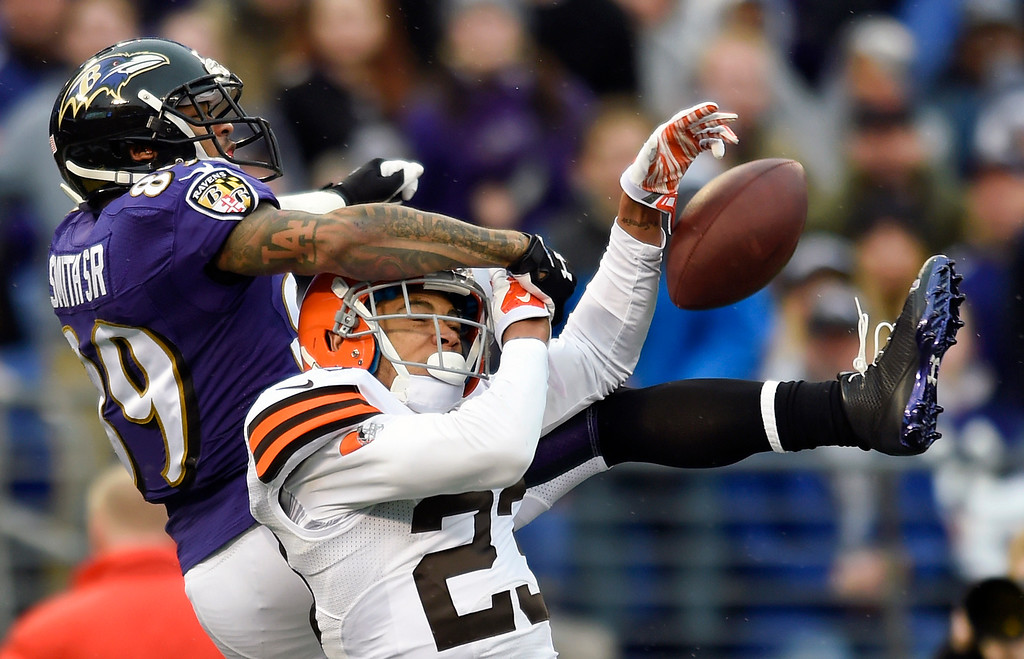 . Cleveland Browns cornerback Joe Haden, bottom, breaks up a pass-attempt to Baltimore Ravens wide receiver Steve Smith in the second half of an NFL football game, Sunday, Dec. 28, 2014, in Baltimore. (AP Photo/Gail Burton)