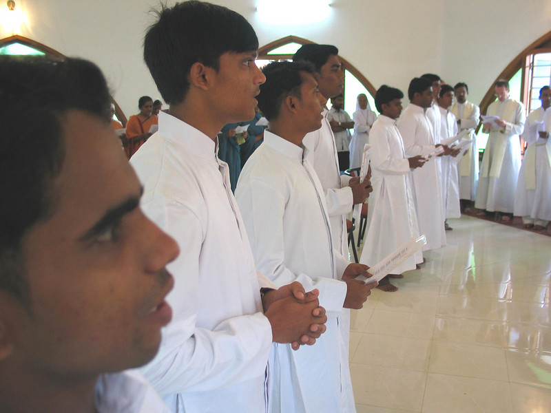The novices are called to stand and declare their desire to make their vows of Poverty, Chastity, and Obedience.