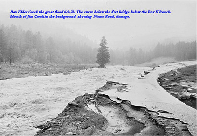Box Elder Creek.  The great flood 6-9-72.  The curve below the first bridge below the Box K Ranch.  Mouth of Jim Creek in the background showing Nemo Road damage.