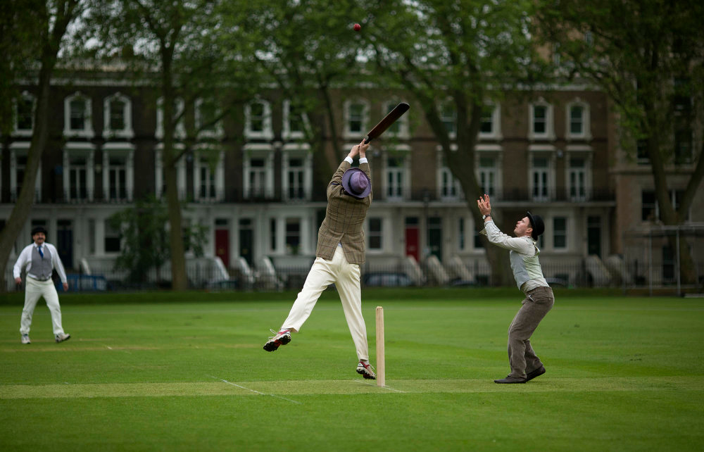 . A batsman plays an unorthodox shot during a Victorian-costume themed cricket match on a wicket in Vincent Square, central London, Wednesday, May 29, 2013. The two-over-a-side Victorian match was held Wednesday to mark the launch of the 150th anniversary edition of the Wisden Cricketers\' Almanac.  (AP Photo/Matt Dunham)