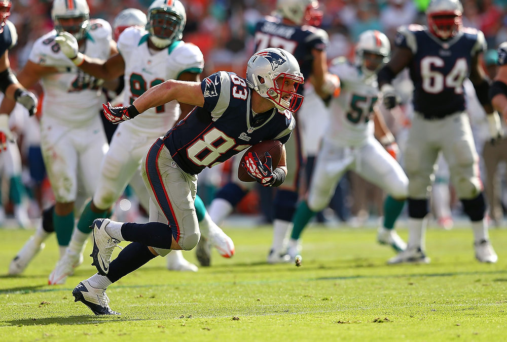 Description of . Wes Welker #83 of the New England Patriots scores a touchdown during a game against the Miami Dolphins at Sun Life Stadium on December 2, 2012 in Miami Gardens, Florida.  (Photo by Mike Ehrmann/Getty Images)