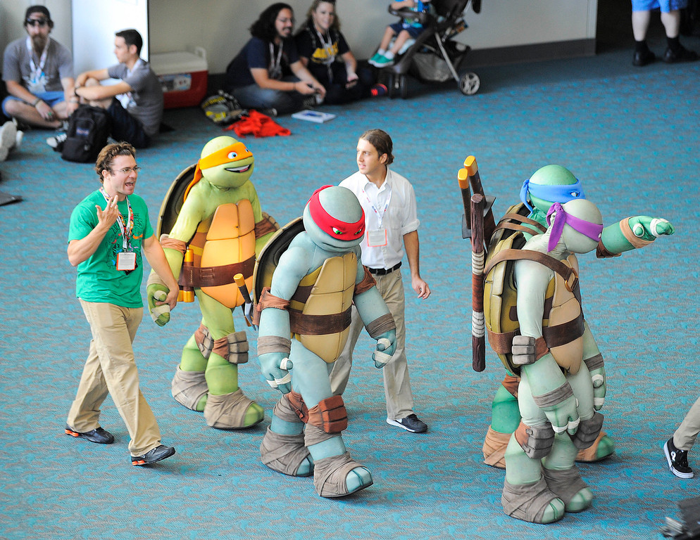 . Teenage Ninja Turtle characters walk through the San Diego Convention Center during the Preview Night event on Day 1 of the 2013 Comic-Con International Convention on Wednesday, July 17, 2013, in San Diego.  (Photo by Denis Poroy/Invision/AP)