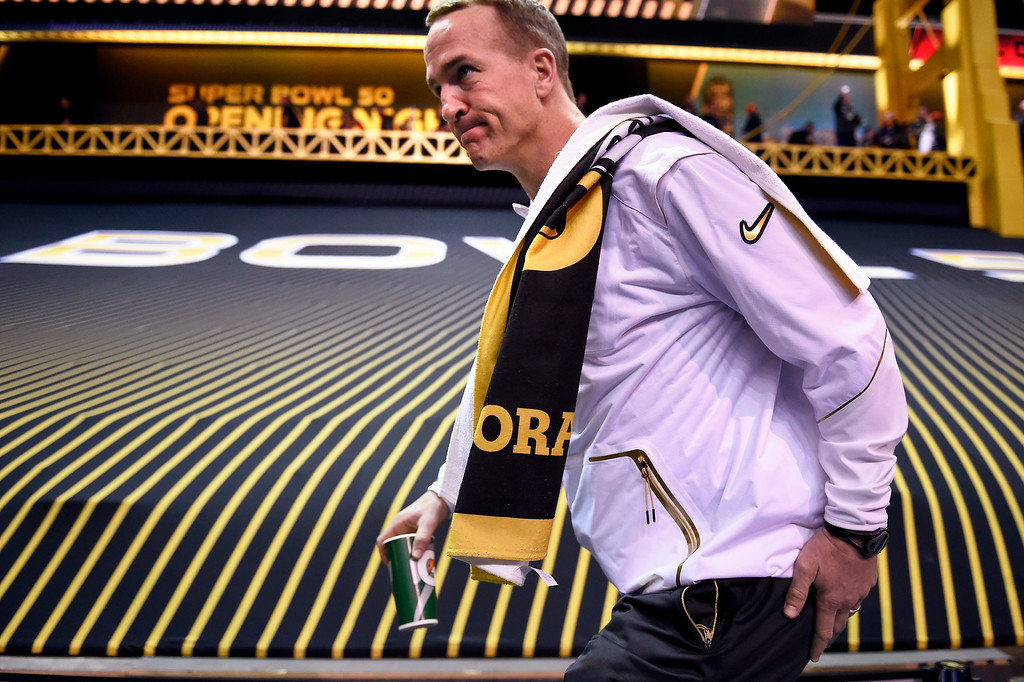 . SAN JOSE, CA - FEBRUARY 01: Denver Broncos quarterback Peyton Manning (18) heading to his booth during Super Bowl 50 Opening Night with the Broncos at the SAP Center, San Jose, CA. February 01, 2016 (Photo by Joe Amon/The Denver Post)