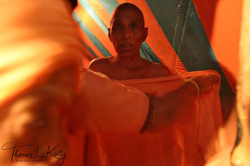 New Initiate getting new saffron clothes of sadhvi. Ujjain, India.