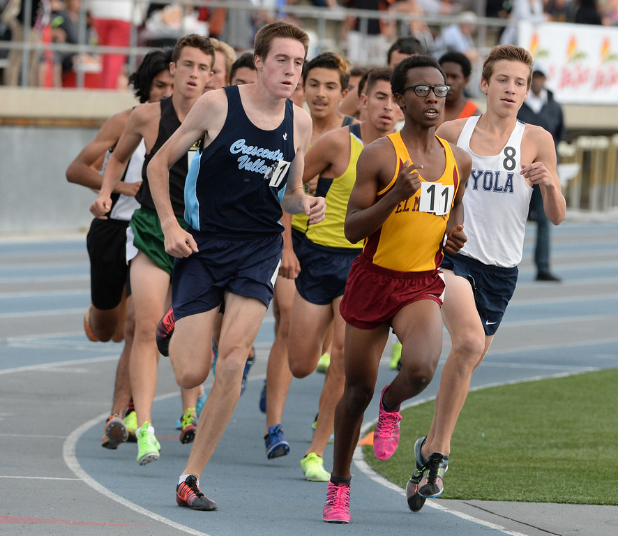 . Crescenta Valley\'s Gabe Collison, left, competes in the division  1 3200 race during the CIF Southern Section track and final Championships at Cerritos College in Norwalk, Calif., Saturday, May 24, 2014.   (Keith Birmingham/Pasadena Star-News)