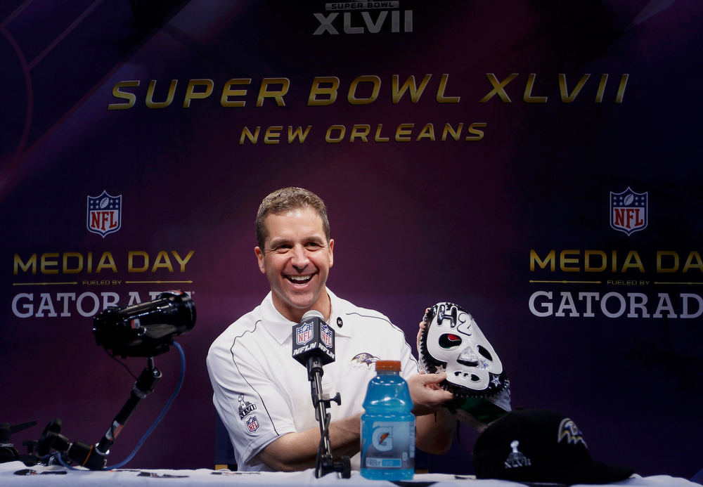 . Baltimore Ravens head coach John Harbaugh holds up a mask given to him by a member of the press during Media Day for the NFL\'s Super Bowl XLVII in New Orleans, Louisiana January 29, 2013. The San Francisco 49ers will meet the Ravens in the game on February 3. REUTERS/Joe Skipper