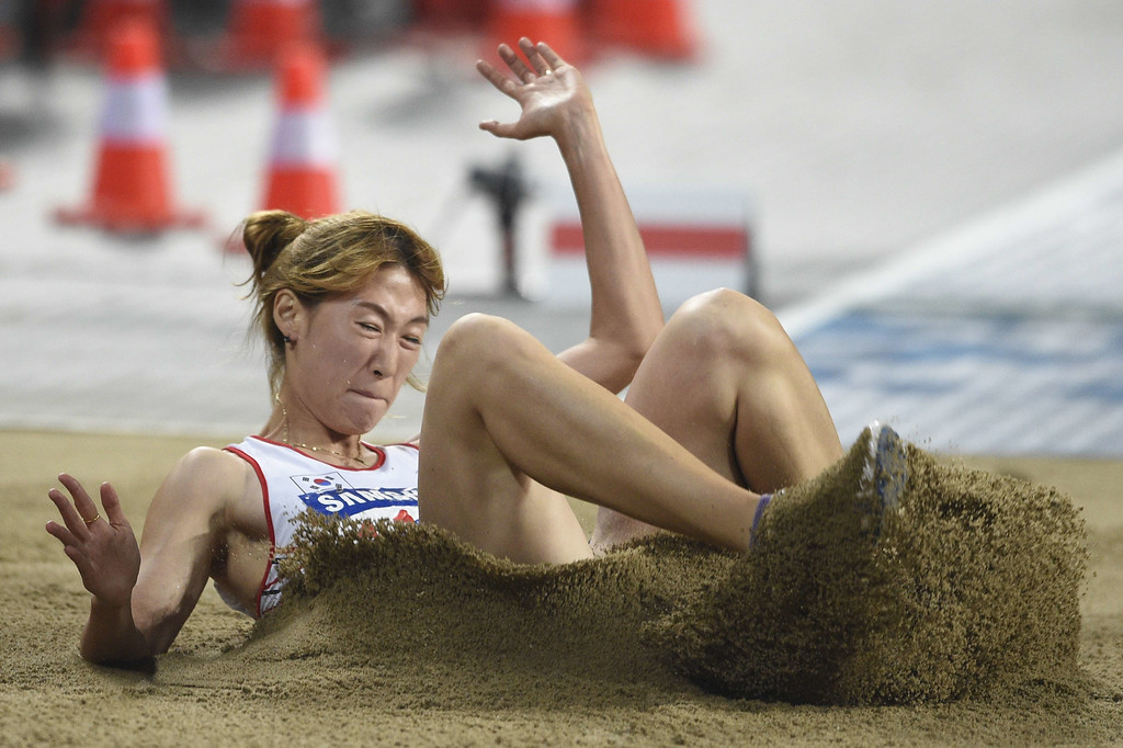 . South Korea\'s Bae Chanmi competes in the final of the women\'s long jump athletics event during the 17th Asian Games at the Incheon Asiad Main Stadium in Incheon on September 29, 2014.  MARTIN BUREAU/AFP/Getty Images