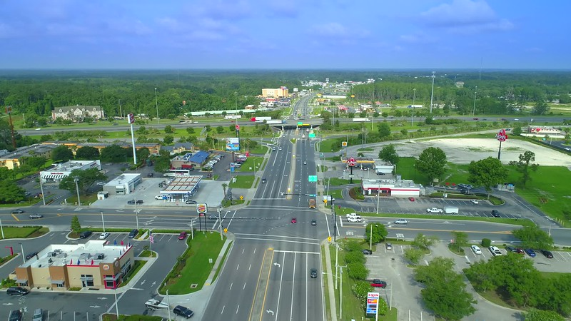Drone footage Lake city Florida business district by highway 90