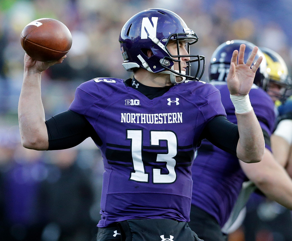 . Northwestern quarterback Trevor Siemian (13) looks to a pass against Michigan during the first half of an NCAA college football game in Evanston, Ill., Saturday, Nov. 8, 2014. (AP Photo/Nam Y. Huh)