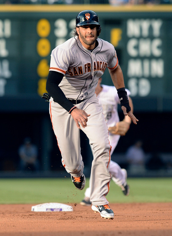 . Giants baserunner Michael Morse made a move towards third base in the second inning. The Colorado Rockies hosted the San Francisco Giants Wednesday night, May 21, 2014.  (Photo by Karl Gehring/The Denver Post)