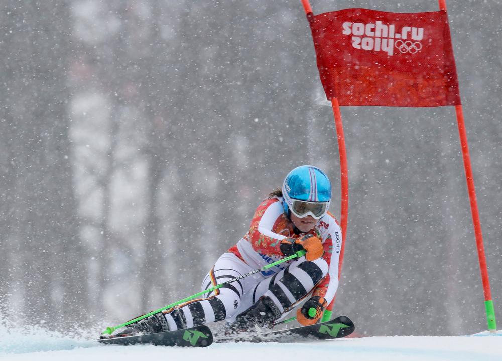 . Germany\'s Viktoria Rebensburg passes a gate in the second run of the women\'s giant slalom to win the bronze medal at the Sochi 2014 Winter Olympics, Tuesday, Feb. 18, 2014, in Krasnaya Polyana, Russia.(AP Photo/Luca Bruno)