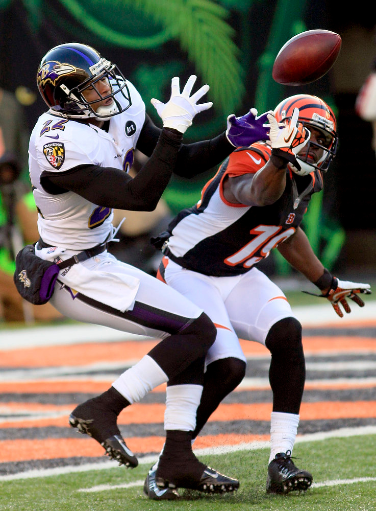 . Baltimore Ravens cornerback Jimmy Smith (22) breaks up a pass intended for Cincinnati Bengals wide receiver Brandon Tate (19) in the second half of an NFL football game, Sunday, Dec. 30, 2012, in Cincinnati. (AP Photo/Tom Uhlman)