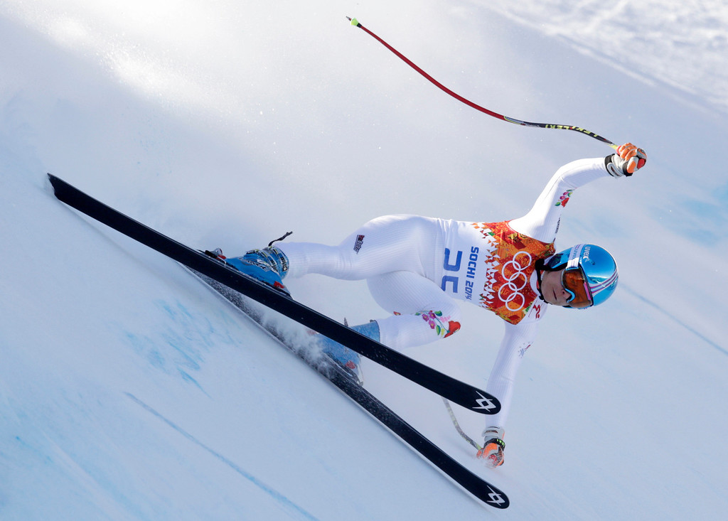 . Hungary\'s Edit Miklos makes a turn during the women\'s downhill at the Sochi 2014 Winter Olympics, Wednesday, Feb. 12, 2014, in Krasnaya Polyana, Russia.(AP Photo/Charles Krupa)