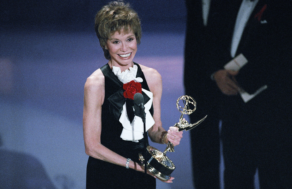 . Mary Tyler Moore, 56, accepts the Emmy for best supporting actress in a miniseries or special for her role in ?Stolen Babies? during the 45th annual Emmy Awards in Pasadena, California, Sunday, Sept. 19, 1993. Moore wrote a new chapter in Emmy history by winning her seventh career trophy, tying the leading Emmy acting talks with Ed Asner. (AP Photo/Nick Ut)