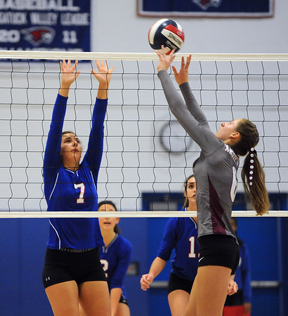 10/27/2018 Mike Orazzi | Staff Naugatuck's Brielle Behuniak (6) and St. Paul's Rebecca Nerbonne (7) in Bristol Saturday.