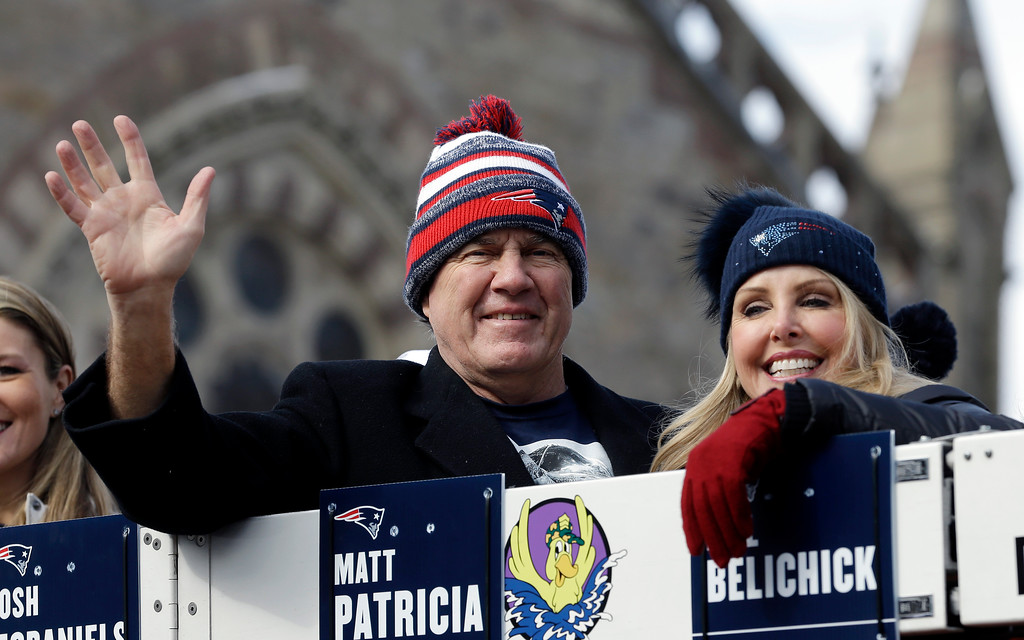 . New England Patriots head coach Bill Belichick and his partner Linda Holliday wave to fans during a parade in Boston Wednesday, Feb. 4, 2015, to honor the Patriots\' victory over the Seattle Seahawks in Super Bowl XLIX Sunday in Glendale, Ariz. (AP Photo/Steven Senne)