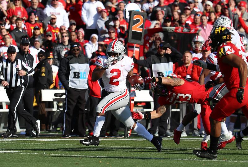 Ohio State RB #2 J.K. Dobbins breaks a tackle by Maryland LBN #33 Tre Watson