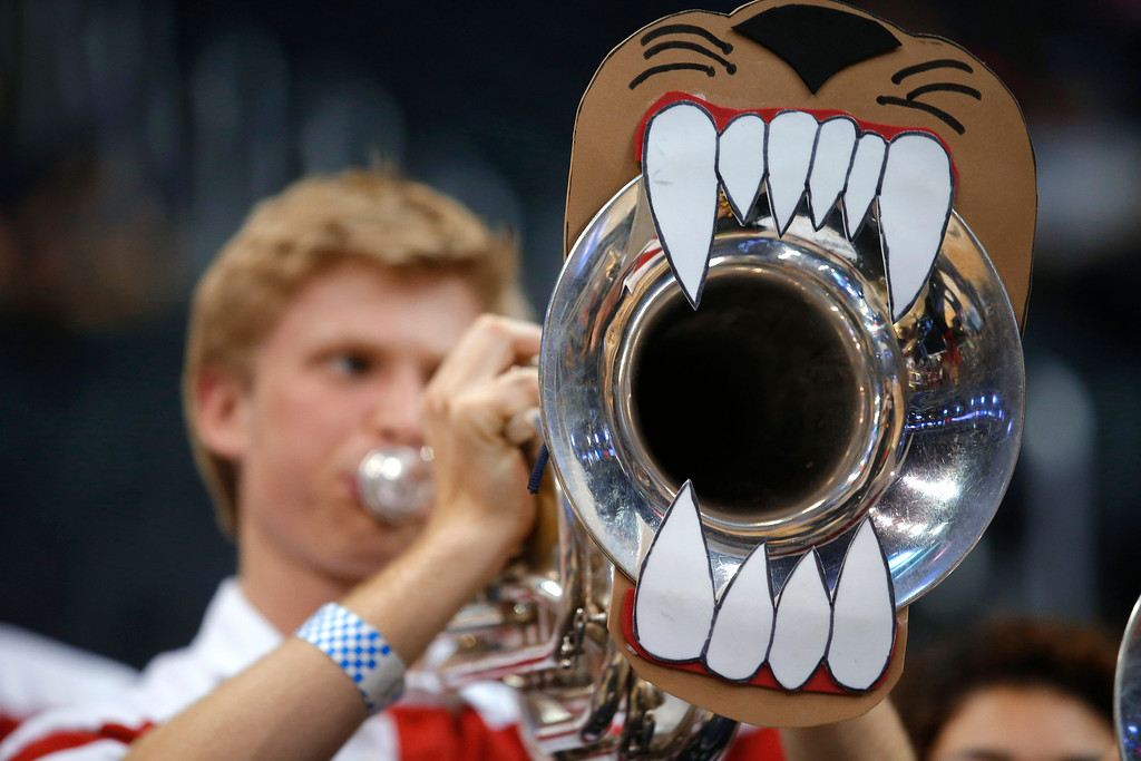 . An unidentified Arizona band member plays before Arizona\'s West Regional semifinal against Ohio State in the NCAA men\'s college basketball tournament, Thursday, March 28, 2013, in Los Angeles. (AP Photo/Jae C. Hong)