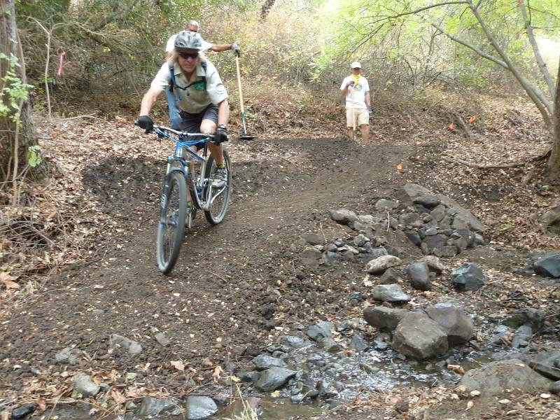 Mark Langton (of CORBA, and also the COSTAC, the Conejo Open Space Trails Advisory Committee) tries out the new trail ramp to cross the stream